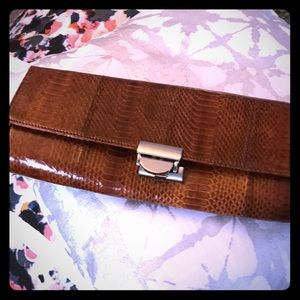 Vintage skin and suede clutch